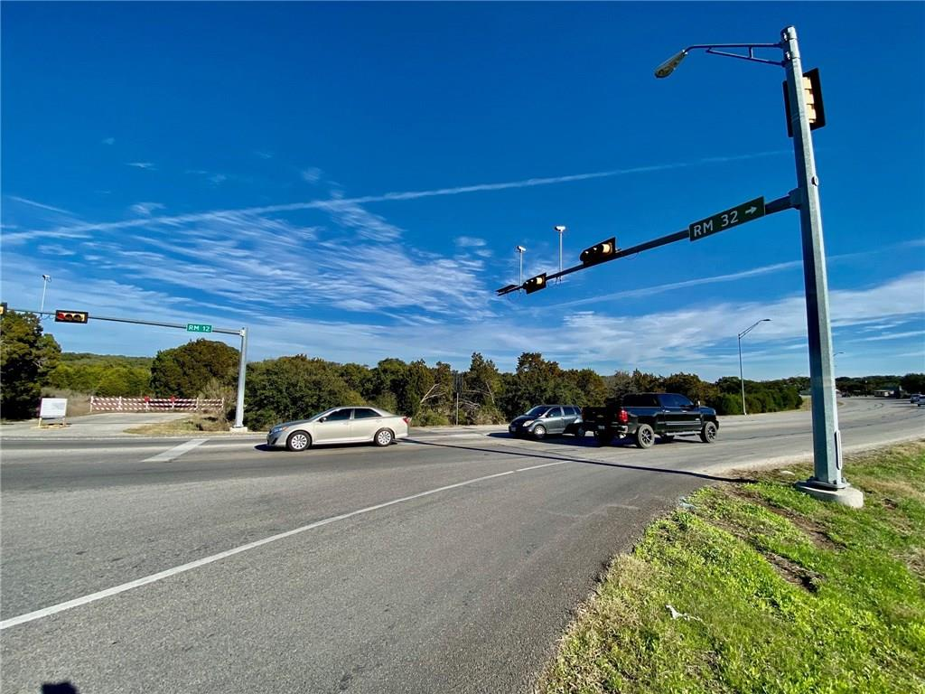 Hays County is the second fastest growing large county in the nation, with traffic counts doubling over the past 10 years. This 8.8 acre commercial tract is well positioned for the discerning commercial investor or developer, with approximately 1100' Frontage along RR12 at the intersection of FM 32 and the new traffic signal. The tract features a recently constructed 30' TXDOT approved commercial drive at the intersection and traffic light. 2018 Daily Traffic counts were 13,148 on RR12 and 7,579 on FM32.