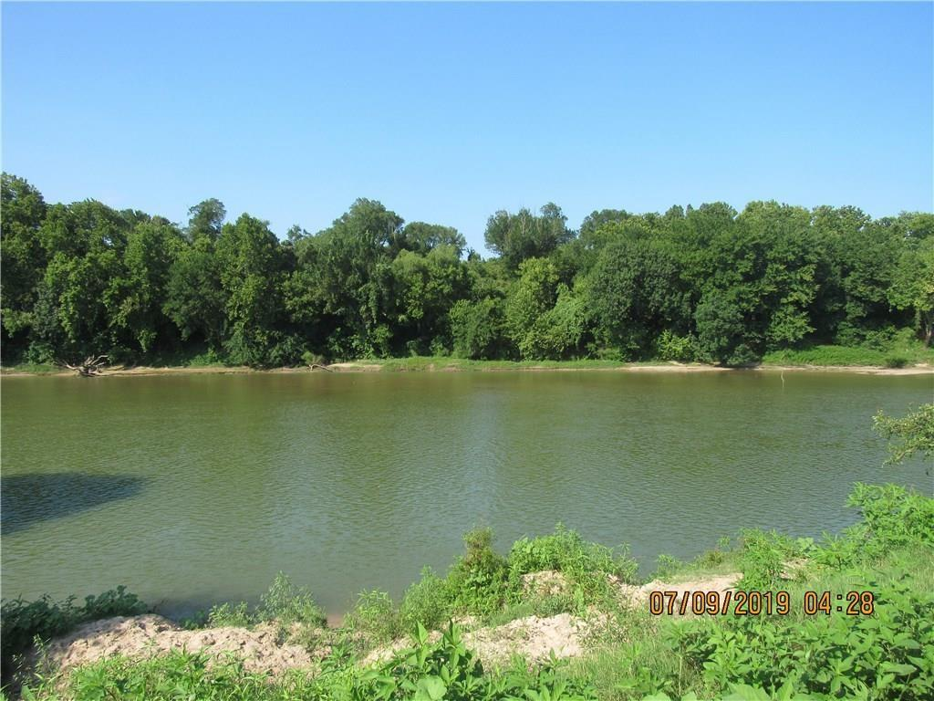 GORGEOUS riverfront property JUST 2 miles from Smithville, Tx.  2654 ft +/- of Riverfront view.