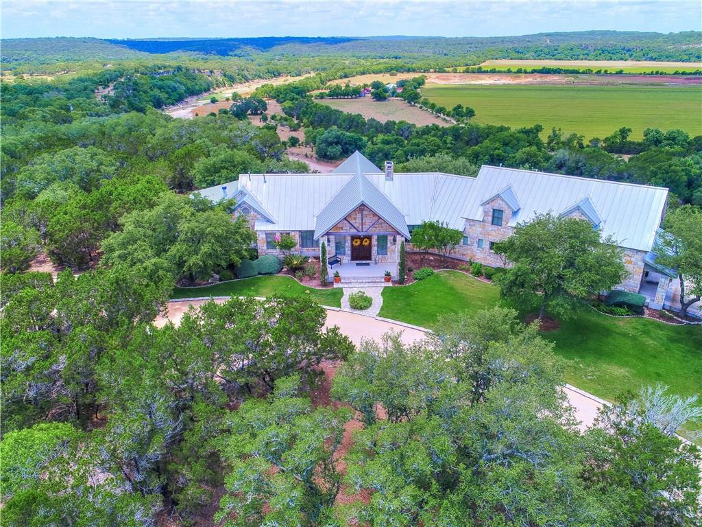 24+/- Acres on Cibolo Creek! Relax as you Lounge by the Pool. This Property Boast a Main House (4948 sq ft, 4 bed/4.5 bath) with Hand Scraped Mesquite Doors, Hickory wood floors, Antique Long Leaf Pine Beams, Gourmet Kitchen, Wine Cellar/Safe Room, Pella Double Glazed Low E Windows, Custom Cabinets, and Storage Room Galore! Additionally, a Guest House (1704 sq ft, 2 bed/2 bath) Perfect for Family or Rental Income; and a 2054 sq. ft. Workshop with 3 High Lift Doors, Car Pit, 220 Voltage, and Compressed AirGuest Accommodations: Yes  Sprinkler Sys:Yes