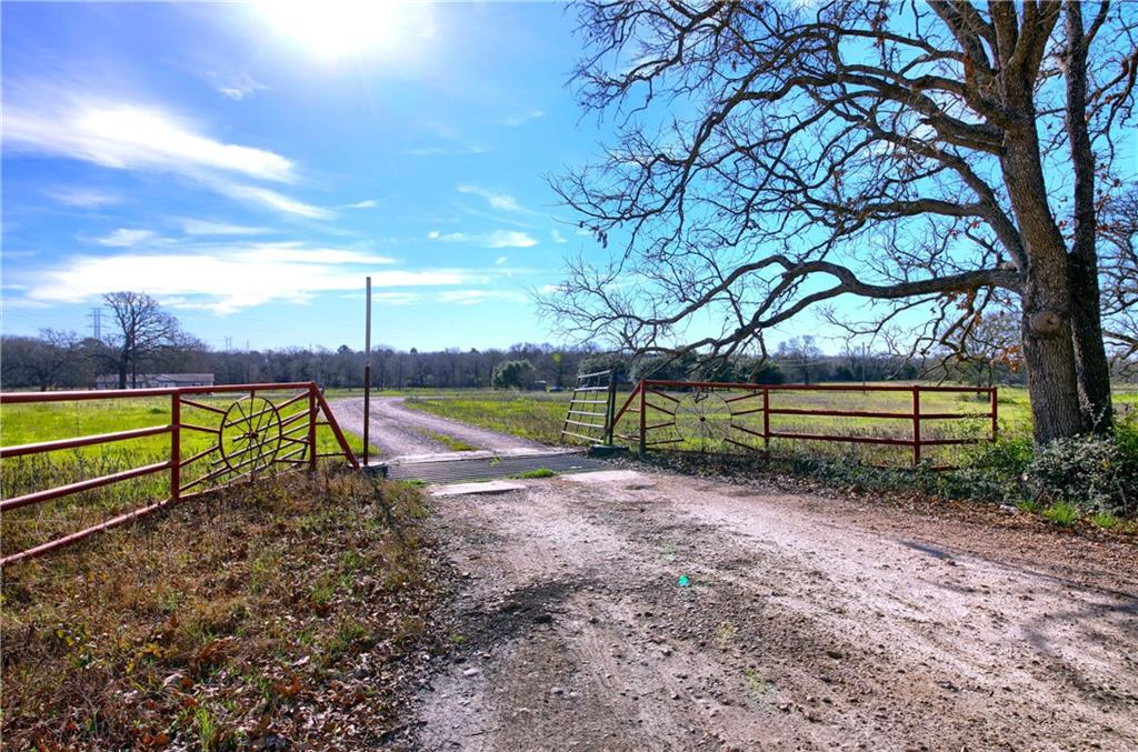 Sprawling property with tons of road frontage and level topography overall! 22+ acres w/ 3 homes (main/2 mobile homes: same make/model) and a POOL!! Great opportunity for possible rental income and development. Plenty of space, tank for fishing, storage, livestock barn!!Owner requires 24 hour notice for showing.