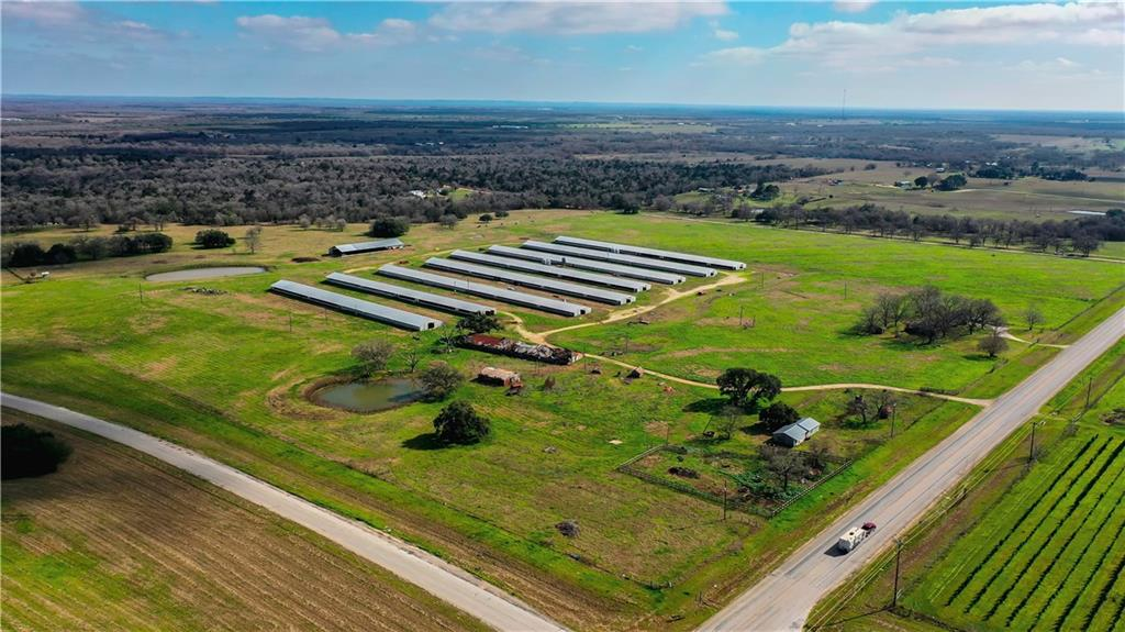 Here is your chance to invest in a prime piece of real estate in Gonzales County. This property conveniently has road frontage on 304 and I-10, and County Road 283 boarders the back of the property. Along with the main residence and chicken houses, the property contains two stock tanks, a 20+- acre pasture, cattle pens, and more.  - 2500+- SQFT Main House built in 1964. - 8 500x40ft Chicken Houses - 1 200x60ft Tractor Barn - 700+- SQFT Workers house - 3 300ft+- water wells – Contact agent –Restrictions: Unknown