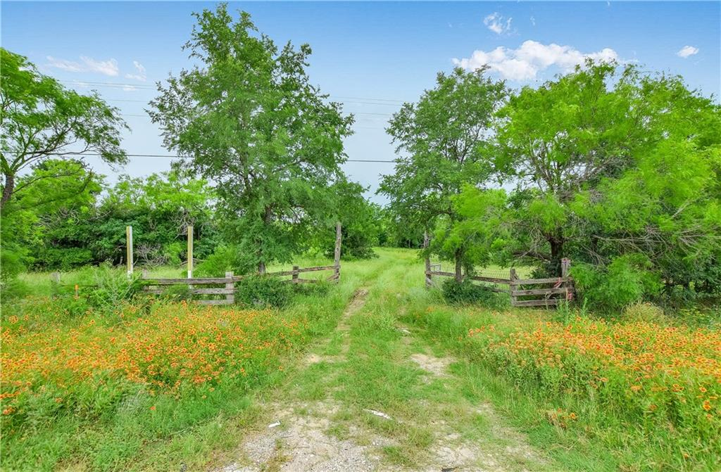 Beautiful 134 acre fenced ranch in scenic Bastrop county! 30 mi from downtown Austin, 8 mi from Circuit of the Americas, 17 mi from Austin Airport-property is in prime growth corridor! 2 large ponds & lots of wildlife. Ideal hunting ranch, weekend retreat, or dream home in the country. Rolling topography w/rich soil, grassy meadows, & towering live oaks. Electric, water, & gas lines located on/at road frontage of property. Over 1000 ft of Highway 21 road frontage-Great development potential! Call for tour