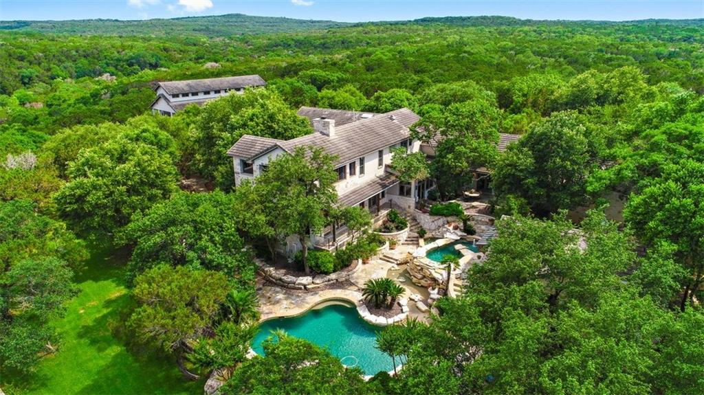 The Ultimate Hidden Compound on 12.64 acres behind the gates of Spanish Oaks. 253 feet of Barton Creek frontage. Backs to 4,100 acre nature preserve. Kayak down the creek, go fishing, ride dirt bikes, drive ATV's . There are 3 structures on the property: The ma in house is 5559 sq ft, 5 bedrooms, 4 full and 2 half baths. The Guest Cottage is 884 sq ft with full kitchen. The 3rd structure is a huge garage with 1488 sq ft office/living/full bath and loft. If you are looking for privacy - this is it!Guest Accommodations: Yes Restrictions: Yes