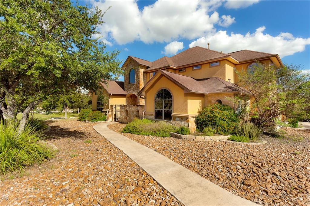 BRAND NEW ROOF! Beautiful one-of-a-kind Gem in the Hills of San Marcos! Accessible to the interstate and close to Texas State University.  This 1.24 acre lot has irreplaceable hill country views from the back of the home. Gourmet Kitchen, Wine room, High Ceilings, Jacuzzi and private workout area in the master, 2 fire places, hot tub, balcony and covered patio, movie theatre room and more.  This home has it all!