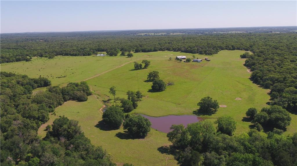 Own a piece of Central Texas history! This property has been in the same family since the 1870's. End of the road privacy, 1-mile long private driveway. Nice custom brick home with ample space for family or guests. Property is ag exempt, and has 3 ponds in place. Great mix of wooded and open areas as well as 70/ of rolling elevation change. Use for cattle, hunting, recreation or all of the above!FEMA - Unknown Restrictions: Unknown