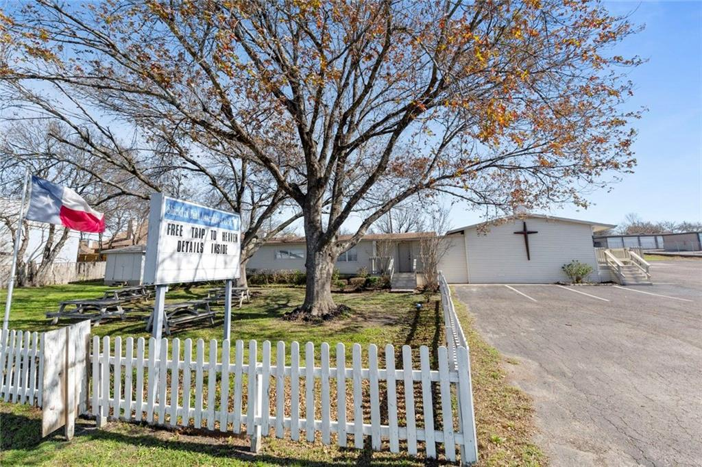Restrictions: Yes Situated on 2.02+/- acres w/ over 200 ft. road frontage; parking for 40. SHINGLES over Sanctuary replaced Summer, 2020. Furniture & fixtures negotiable. Original structure built in '76; features kitchen (no dishwasher); two restrooms; & four classrooms. Separate Pastor/Admin building features two large offices; full kitchen; living room & 2 full baths & is suitable as Pastor's residence. Close to IH-35. Surrounded by neighborhood on two sides & commercial. Buyer responsible to verify data/city codes.