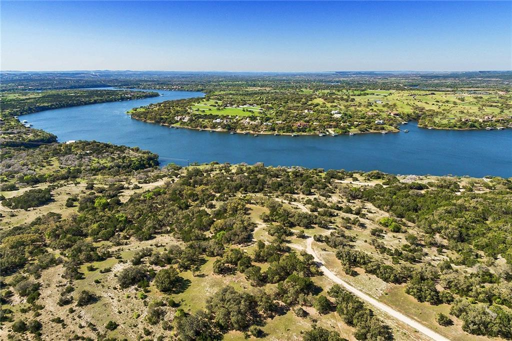 171 ACRES - Lake Travis waterfront with cove. Over 1/4 mile of deep water frontage. Arguably the best topography and views found anywhere on the entire lake. No restrictions (per title company), Ag exempt and only 45 min from Austin. Cleared cedars, improved roads, underground electricity, 2 water wells (one is +100GPM), 2 private ponds/tanks with waterfall, abundant wildlife. Rare development/investment opportunity, or the ideal recreational ranch. Owner financing available.