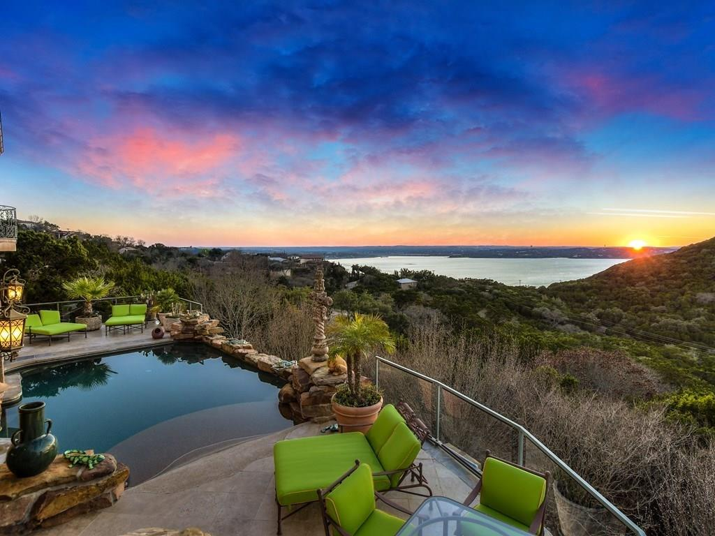 Stunning Lake Travis villa with breathtaking views throughout. This 6200 sf, 5 bdrm, 5.5 bath includes separate guest quarters and the perfect setup for entertaining. Two wide terraces, infinity pool/spa and cabana bathroom. Stone deck and accents. Living room with soaring barrel ceiling and a showstopper stone fireplace. Wide-open living space on second level. Wine cellar and wood-paneled elevator. Custom cabinetry in kitchen. Professional-grade stainless steel stove, eat-in bar, granite countertops...Guest Accommodations: Yes Restrictions: Yes  Sprinkler Sys:Yes