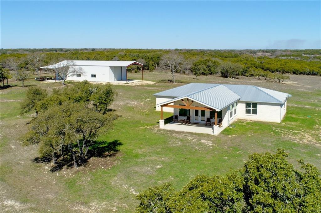 Meticulously cared for 120+ ac hill country hunting ranch w/ custom 4 bd, 4 bath, 100% stone home for sale in Bertram, TX. A virtually new, lightly used home has high end finishes and is perched on a high point that offers incredible views from the large covered front porch. Wildlife includes whitetail, hogs, turkey, dove and predators. Topo is level to sloping w/ native grass pastures and fertile black soil. The newly built 30'x70' metal barn has three roll-up doors, lights and slab. Wildlife exempt & no restrictions.