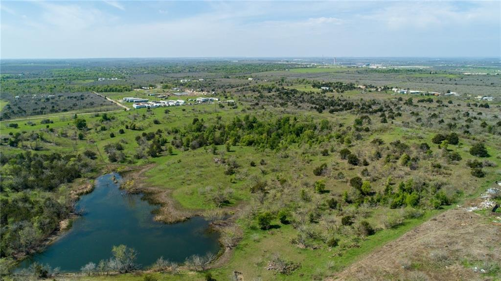 **** AUSTIN OPPORTUNITY ZONE**** Beautiful Rolling Hills!  Pond on property!!  Build a house with City views or have a Weekend Ranch!Restrictions: Unknown