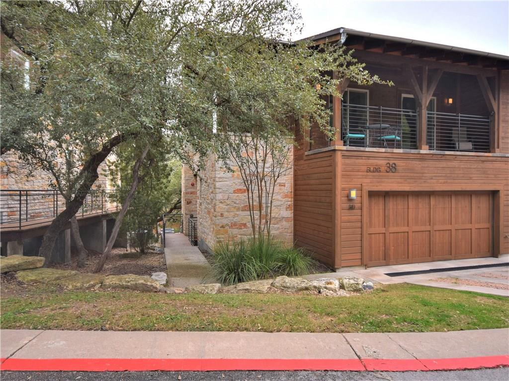 ~Facetime, video tours or in person showings allowed ~Luxury condo nestled in the hills w/ greenbelt & wooded views ~Gated; easy access to 360, 183, Mopac & 620 ~High end finish out w/ wood flooring in most of condo, carpet in bedrooms ~Island kitchen has gas cooktop, SS Bosch appliances, under cabinet lighting & open to family room ~Owners suite w/ garden tub, walk in shower, granite counters & walk in closet ~Upstairs loft-use as office, play area, exercise area or 2nd living area ~2 car garageRestrictions: Yes  Sprinkler Sys:Yes