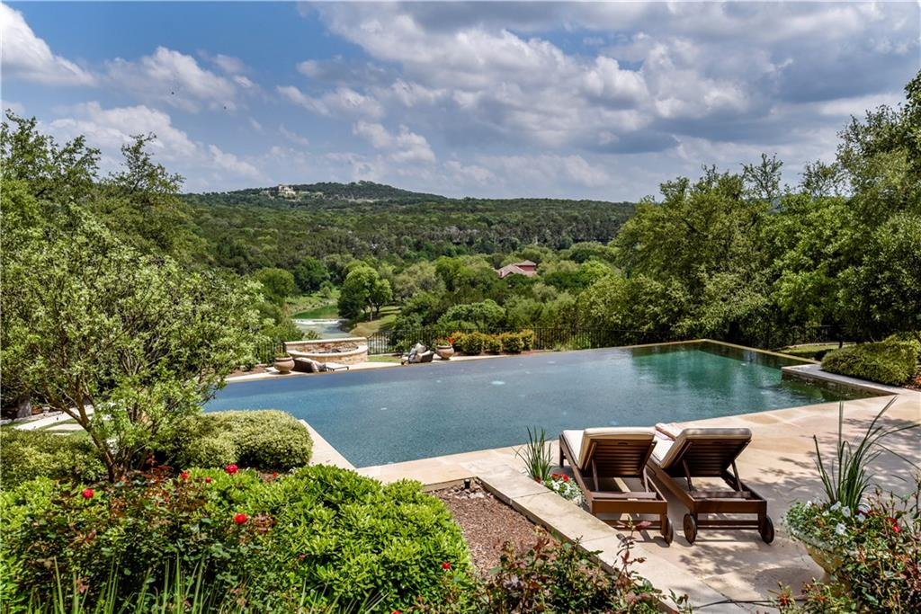 Incredible French Country Waterfront Estate Located behind the gates in the premiere Golf Course Community of Spanish Oaks. This 10.6 acre equestrian estate overlooks the famous Barton Creek and offers 90' of crystal clear water frontage. The land is mostly flat with beautiful native oak trees and a welcoming fountain, the meticulous landscaping and thoughtful hardscape are pleasing to the eye while commanding panoramic views of the Texas hill country and creek makes it the ideal location for this very special one-of-a-kind European estate. The Main House offers 7 bedroom, 7 Full Bathrooms and 2 Half Bathrooms, Generous chefs kitchen and prep / catering kitchen, 3 Fireplaces, Office, media and game rooms and much more. In addition the estate offers a 2 bedroom guest house with full kitchen, large living room with stone fireplace and private office, a 4 stall Morton barn w/ tack, outdoor corrals, riding pens, a sport court and gorgeous infinity edge pool overlooks the amazing views of the hill country.  Designed by Jack Arnold, A.I.A. Jack is known across the U.S. as an expert in European residential design. Lake Travis ISD Please visit: MusketRim.com/?mls for additional details