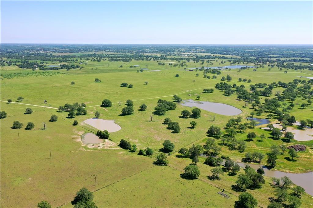 Enjoy the recreation & leisure this 207.576 ac has to offer! Turn key cow/calf operation & hay production, level, open pastures w/Post Oaks. Suited for horseman & dog trainers as well. Ample water sources w/5 ponds (3 stocked), 2 wells (1 hand dug/1 drilled), & Lee Co. Water. Barn, shed, corrals/gates/chutes, cross & perimeter fencing for pasture rotation, aerobic septic, elec. & phone, & 100 yr house used as shop/storage. Minerals NEG/active lease. Non-realty farm equip for sale. Inc. PID 17638 & 85464.Restrictions: Yes