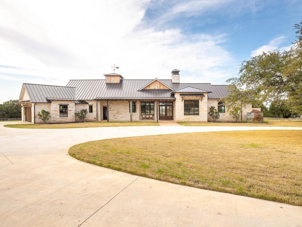 Gentleman's Ranch with Panoramic Hill Country Views! *2019 Custom Farmhouse-4 beds-4 1/2 baths-Open Concept Common Areas-Antique Beams, Doors, Posts-Incredible Quality & One-of-a-Kind touches throughout! *Casita remodeled in 2016- 1 bed-1 bath-loft with farmhouse feel *Pool* Multipurpose Barn (outdoor dining/seating/barbecue, storage, 4 stalls, play area, courtyard) *Entertainment Barn w/movie screen & projector* Riding arena *Fully fenced & cross fenced* Gated *Super private!* Dripping Springs schools