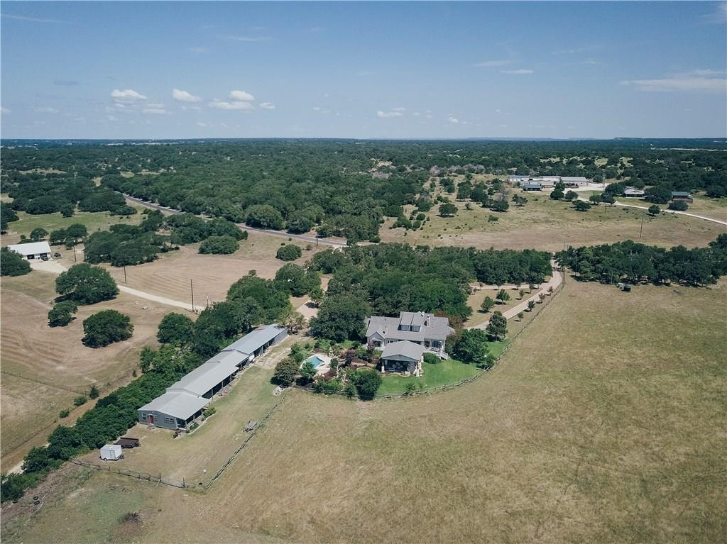 tHIS IS A 3 BED/2 CHARMNG COUNTRY HOUSE WITH A TEXAS CABIN WITH 2 BED. HOUSE IS SITTING IN 3 ACRES SURROUNDED BY 200 ACRES OF LAND. IT HAVE A SMALL SWIMMNG POOL AND INCREDIBLE COVERED PATIO FOR ENTERTAINMENT. IF YOU WANT ONLY THE HOUSE CALL FOR PRICING.Guest Accommodations: Yes  Sprinkler Sys:Yes