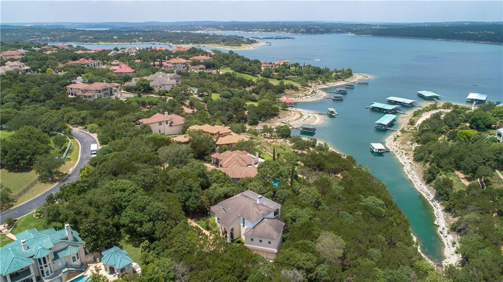 Incredible opportunity to buy a beautiful home with amazing views overlooking Lake Travis. Located in the gated community of Vineyard Bay. The huge family house has tall ceilings, large windows and decks running along the back of the home. Features include open kitchen, built-ins and two fireplaces and a boat slip. Recently remodeled community complex with a gorgeous pool. Great clubhouse featuring gym, sauna, meeting/event rooms, playscape, game courts and an events field that also serves as a heliport.FEMA - Unknown Restrictions: Yes  Sprinkler Sys:Yes