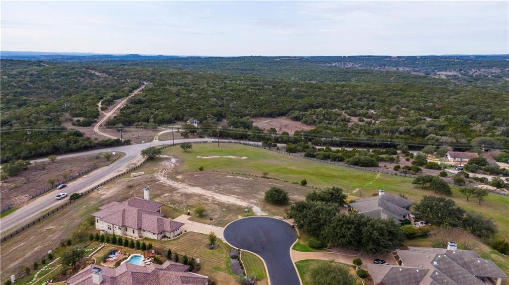 Great cul-de-sac lot of .528 acres that overlook rowing hills that provide beautiful sun sets and rises. The lot has a  gentle slope to the community gate at the end of the lot. Located in the exclusive gated and guarded community of Barton Creek Lakeside. Private country club but membership is voluntary and includes 18 hole golf course, pool, fitness center, tennis, dinning and 3 minutes to subdivision boat ramp.Restrictions: Yes