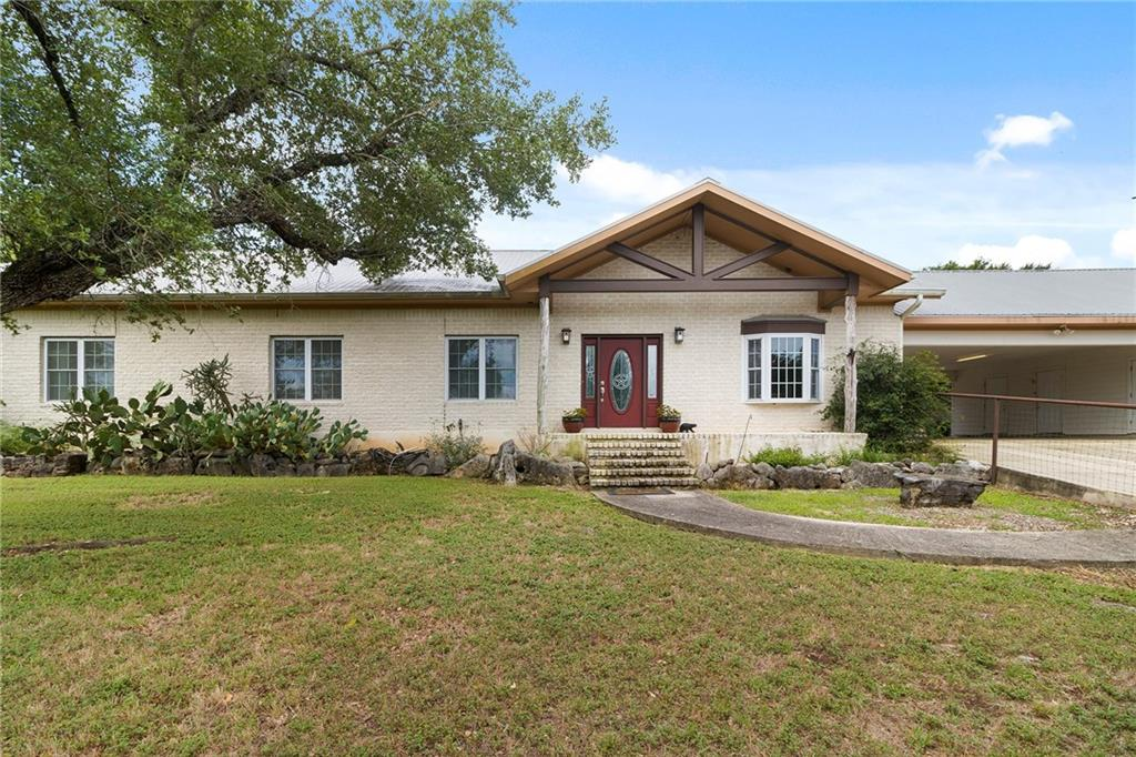 Stunning Central Texas Estate just outside the Booming Town of San Marcos. Easy drive north to Austin or South to New Braunfels or even closer to Texas State University. This 2374 sqft ONE story home sits back on a private 20 acre estate. The bright, open floorplan has a HUGE Country Kitchen that is open to the Family, Living & Dining Rooms.  Truly an incredible Family Entertaining Home. Great covered back porches overlooking the Oak Tree filled yard. Incredible Workshop (it's insulated).Come take a look.Restrictions: Yes