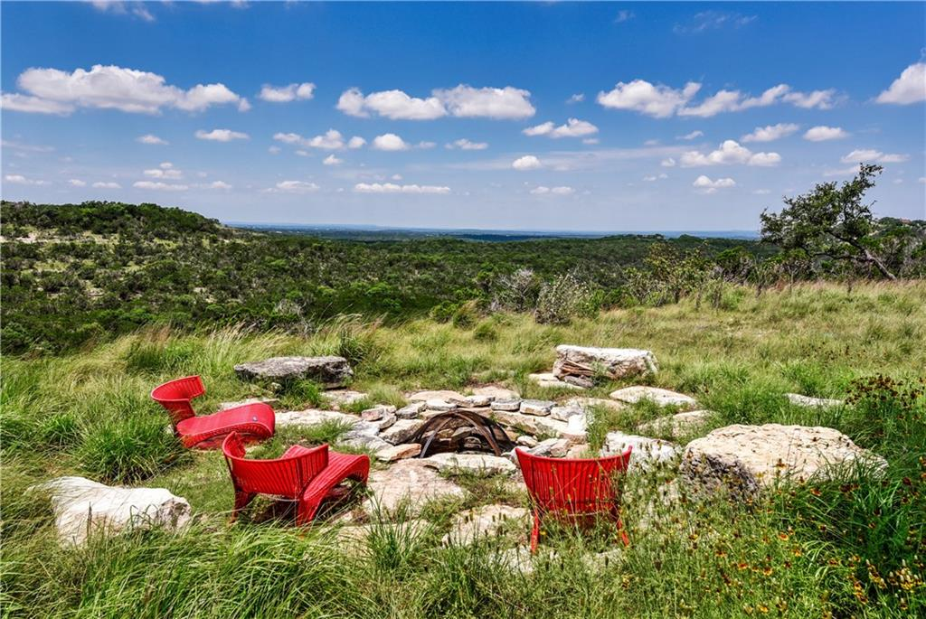 *New asphalt road and entry gate being installed, photos coming soon* Level building sites & long-distance unobstructed views. Enjoy complete privacy yet easy access to Dripping Springs & Bee Cave. Strategic clearing has been completed allowing the oaks to flourish while maintaining the natural character & privacy.Restrictions: Yes