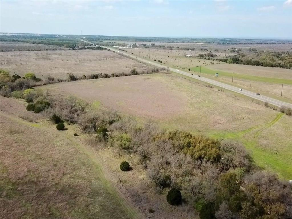 Beautiful unrestricted 20+ acres with over 2300 ft of Hwy. 71.  The possibilities are endless for this property.Restrictions: Unknown