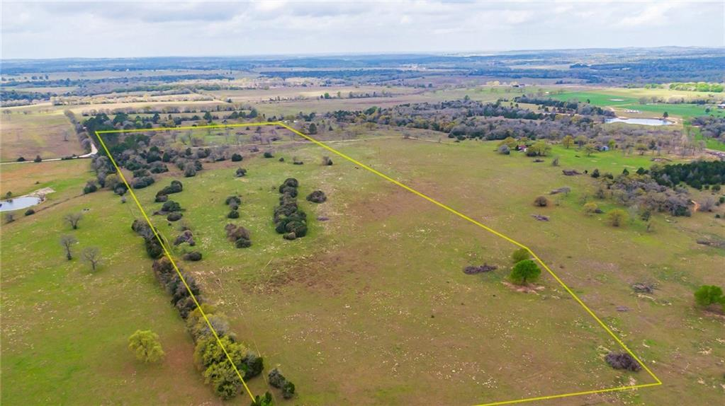 A chance to have your own ranch just 40 minutes outside of Austin. Rolling hills and ultra healthy vegetation make this fenced tract an ideal locale for livestock or an estate home. Complete with a tank for fishing and 100% privacy just minutes outside of booming Giddings/Paige, this acreage is situated down a quiet road ready for your development.