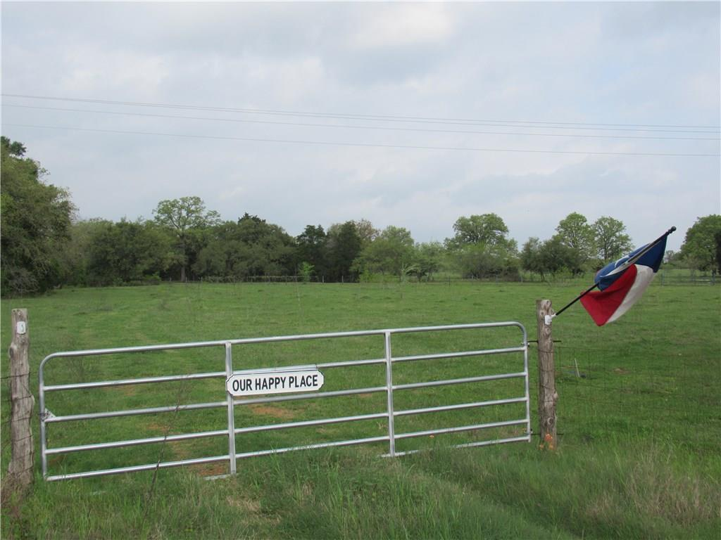 This acreage has beautiful home sites available under gorgeous oak trees !!  There are restrictions and very close to Smithville  ~ Electric and water already in place with 3 spigots, low water crossing and completely fenced.  Already has ag exemption with neighbor's cattle ~Restrictions: Yes