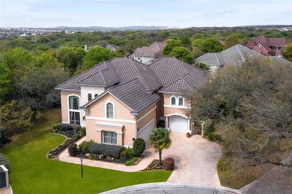 Beautifully appointed home on a peaceful cul-de-sac in The Reserve boasts tile flooring, dramatic entry flanked by formal living & dining. Grand family room w/chef's kitchen features ss appliances, gas cooking, wine fridge, dbl ovens centered by a granite island. Master down w/private patio access has Luxe bath with his/her vanities centered by jacuzzi tub and grand shower. 2nd master down. Stately staircase leads to 4 spacious beds up w private media/gameroom. Lush yard has a koi pond & room for a pool!Guest Accommodations: Yes Restrictions: Yes  Sprinkler Sys:Yes