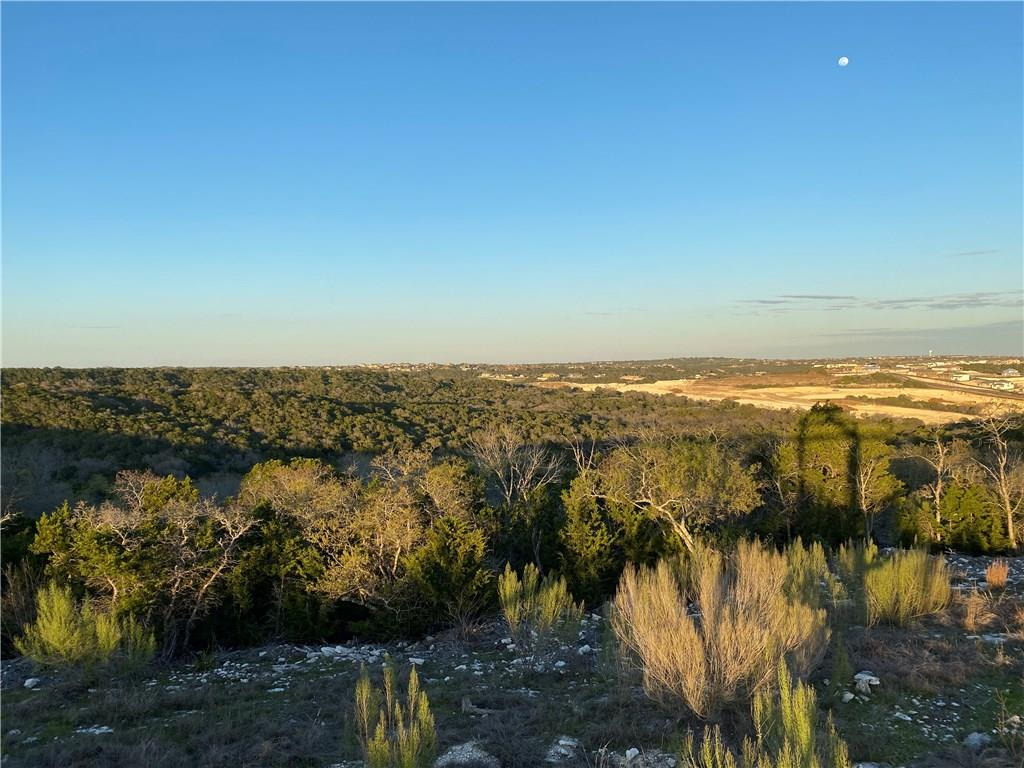 Incredible panoramic view of the beautiful hill country from this expansive property. Fabulous opportunity for 12.5 acres minutes from Cedar Park on the hilltop. Fully insulated 4,500 sq ft metal warehouse w/ 1000 sq. ft air conditioned office/work room can be converted to a barndominium. Slab foundation and steel framing for beautiful 3,000-5,000 sq. ft house.Restrictions: Unknown