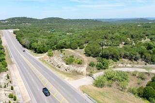 18.8 acres within Lago Vista city limits. FM 1431 frontage belongs to the state, but access has been granted for a right turn lane onto FM 1431, but could also access from Destination Way. Three parcels join to form the 18.8 acres. Mostly level with enough height for an amazing hill country view. Utilities nearby.  Great visibility from FM 1431. The Hollows is busy with new construction. Buyer should verify all details.Restrictions: Yes