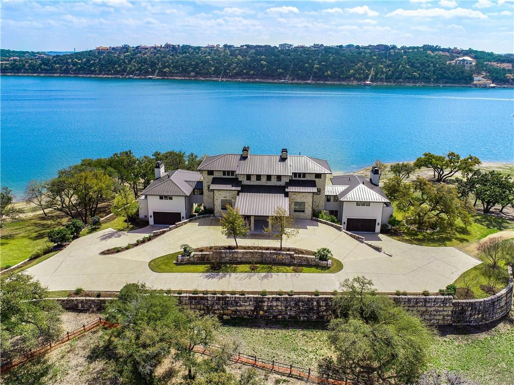 "Developer's family estate, on Main Body Lake Travis. A rare homesite, with a ""Walk to the Lake"" shoreline and easy private boat dock access. The Modern meets Ranch architecture, has fresh timeless design finishes and warm tones to give a clean, yet comfortable lake living feel. The floor plan was designed in mind, with visiting adult family, providing flex space for private, family fun. Amenities: Lazy River Swim Park, 150 Slip Large Yacht Marina, Clubhouse, Lakeside Lodge and Tennis!Restrictions: Yes  Sprinkler Sys:Yes"