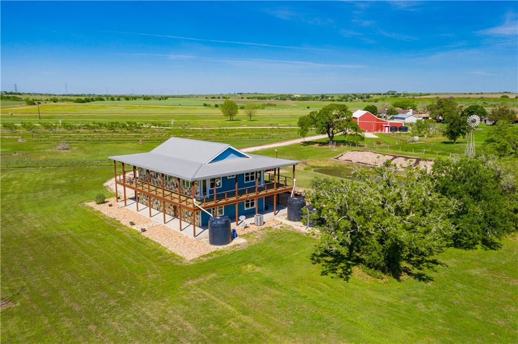 Get a taste of Texas like no other!! 16.426 acres, currently a peach and blackberry farm know as Born In Zorn Farm. 2182 sqft. home, 5 bedroom 3 bathroom w/ wrap around covered porches with amazing unobstructed views for miles!! Beautiful .25 acre rain irrigated stock pond.  Spacious barn w/ commercial kitchen, sales room, restroom and welding shop. Over 100 peach trees and 9 rows of blackberries! Potential for a winery, wedding venue, horse property or expanding current business. This farm will WOW you!Restrictions: Unknown