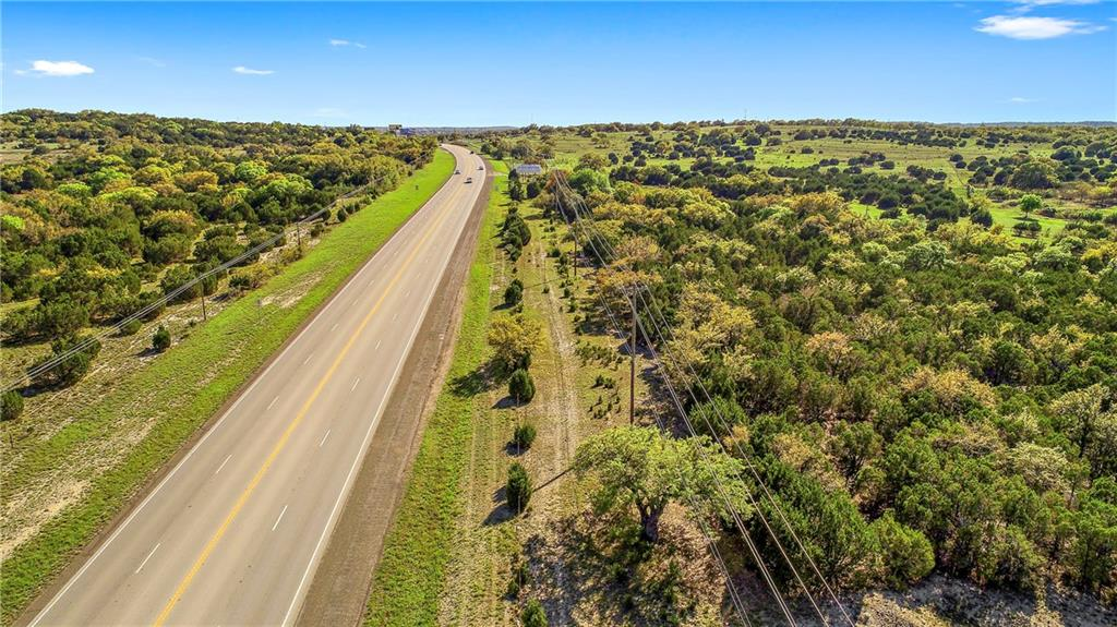 FEMA - Unknown 13.048 Acres with 1550+/- ft of frontage on US HWY 281 in Round Mountain TX. This is a prime location in one of the fastest growing areas in the USA. Property offers some fabulous Live Oak trees. The opportunities are endless here. Great site for commercial use. Seller will consider dividing. Scott and White hospital is less than 10 minutes north. Note: Property taxes to be determined for 13.048 AC out of larger tract. Land Only No Improvements or utilities on property.