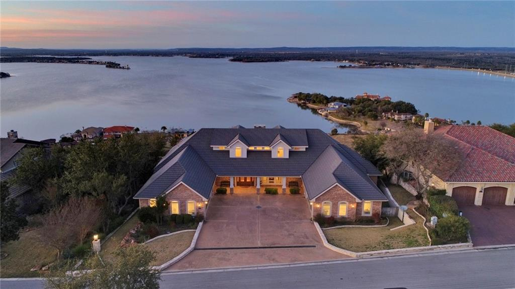 Experience outdoor living on an unprecedented level with an expansive back veranda overlooking Lake LBJ with sunsets that has no rival. Relax in the moment a seems to last forever and be moved by the beauty that is 109 Dalton Circle. This updated traditional home, boasts 4 bedrooms and 4.5 bathrooms with single level living at its finest. Living in this home feels like you hover above the lake and the entire Hill Country. Not many homes of this caliber with these views become available for purchase.Restrictions: Yes  Sprinkler Sys:Yes