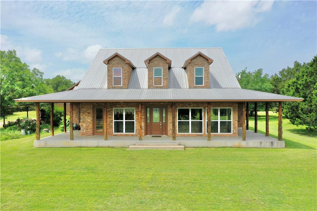 Secluded, very private 75+ ac ranch close to town & only 37 mi from AIBA! Beautiful custom Hill Country style home is handicapped accessible w/wraparound porch! Outstanding 30 ac pastures surrounded by wooded acres.  Panoramic views (amazing view of stars), lots of wildlife, huge catfish pond + 2nd pond! Excellent fences & working pens, 30 X 40 shop w/3 overhead doors & 8 addl. bays for eqpt/storage. Ag exempt (livestock) w/wildlife potential! Owner is TX Real Estate Broker. See list of special features! Sprinkler Sys:Yes