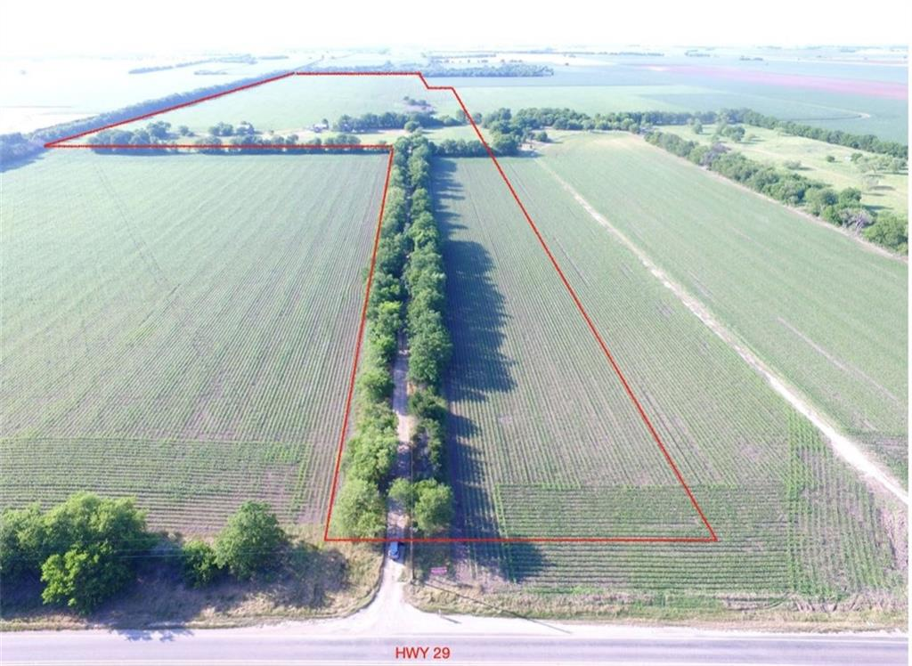 Appx 98 acres to be surveyed off larger parcel-includes old farmhouse, barn, well, electric  No known restrictions- per title research- currently in AG valuation (AWESOME DIRT) located in GISD, yet outside of the ETJ, Jonah Waterline at HWY 29 – fully treed perimeter for amazing privacy  LOCATED IN QUALIFIED TAX OPPORTUNITY ZONE!Restrictions: Unknown