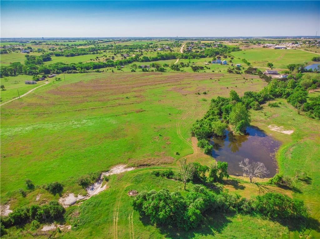 This 64.4 acres ready for boarding, training with a 378 x 178 lighted arena, 9 stalls w/turnouts, barn to