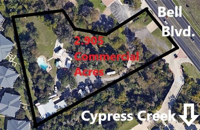 Prime Cedar Park Location! Next to Cedar Park redevelopment area! Located next to CVS on busy Bell Blvd. This property has 200 plus feet of frontage on Bell Blvd.! High traffic count! Perfect for a business that would like to build to suit: retail, restaurant, senior living, offices, hotel, RV, etc.  Currently has 2 commercial septic systems, commercial well, 1,402 sq. ft. house, large concrete pool, beautiful trees...value is in the land and great location!Restrictions: Yes