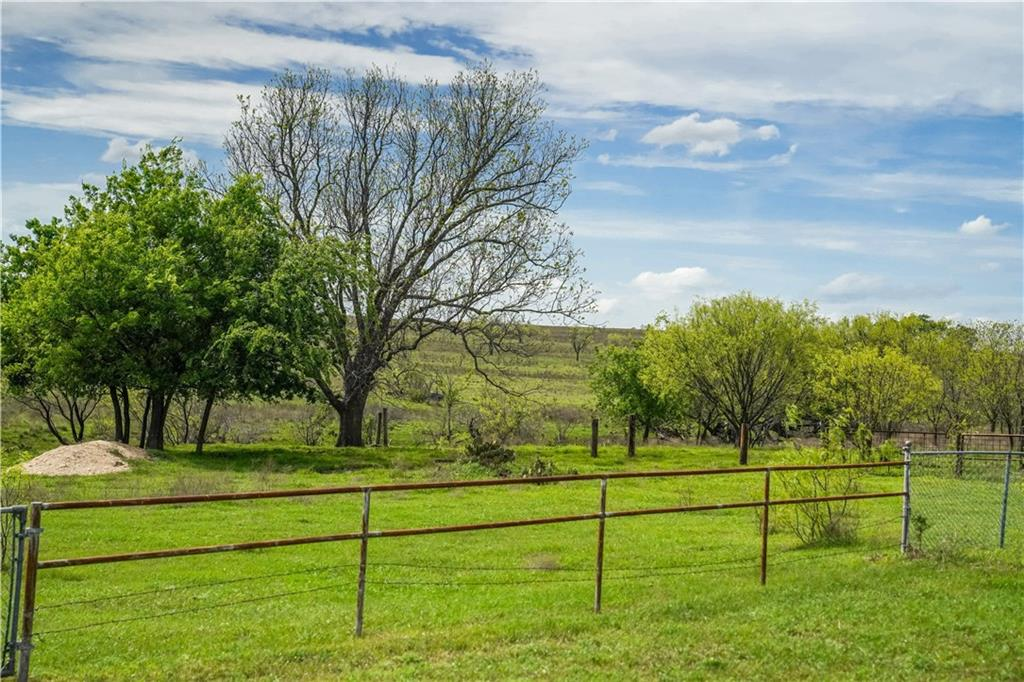 This longtime working family 252 acre ranch is versatile and has views for miles.  Level pastures great for raising cattle for an ag exempt or cropping.  Wet water creeks run throughout.  Small stock pond in the middle.  Older 2/2 home has good bones but needs work.   One Pole barn and other  metal structures on site for storage.  Fencing on all 3 sides.  Water and electricity available.  Can be sold as a whole or subdivided into 3 parcels that have already been surveyed. 1.5 miles to AustinFEMA - Unknown Restrictions: Yes