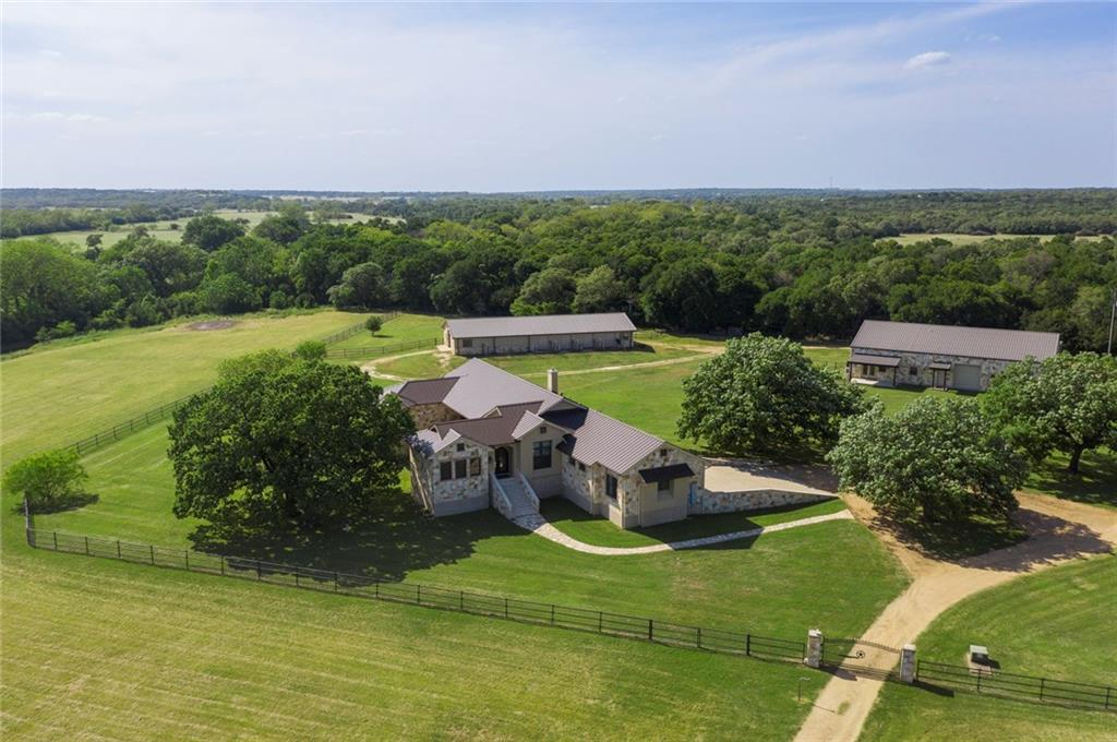 For ranch and country living, this premier 29-acre ranch estate on Salado Creek in the Spears Ranch equestrian community is a must to see. 40 minutes NW of Austin. Beautiful 3bd/3.5ba custom home, open plan, with unique attention style, quality, and comfort. Pastures on both sides of creek, oaks, towering pecan trees. Separate 2/2 guest apt. Shop w/RV storage. Horse barn, stalls, kennels. Ideal youth activities with at-home fishing, trail riding, 4-H activities. Now is the time to see.Guest Accommodations: Yes Restrictions: Yes