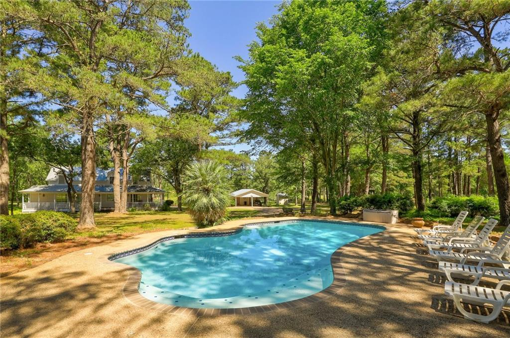 Picturesque Gentlemen's Ranch on 80 acres of coastal hay fields located 45 minutes from Austin just off 290. Main house is a 2 story 3 bed, 3 bath with huge 2 sided wrap around porch surrounded by massive pine trees. Also includes recently updated pool, 4 stall horse barn, tack room, full-sized workshop and greenhouse. There is a 2 car carport with storage and an additional covered RV parking spot.. 2 br/1 ba guest/ranch foreman home with fireplace, full kitchen and living area.Guest Accommodations: Yes Restrictions: Yes