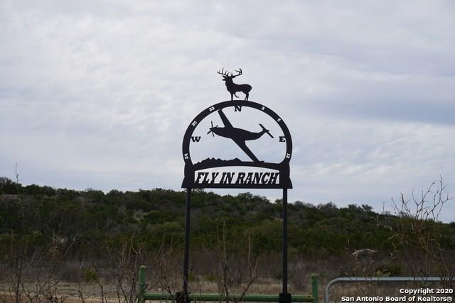 FLY IN RANCH, 383.40 AC Features a 2400X300 grass level landing strip(4 TAX ID'S: 144100,0144095, 144098) Please verify all taxes, schools, HOA, sqft. Modular hm 3/2/ Bunk house - sleeps 6, 1 bath & kitchen/ covered, bbq area/ Tall Metal storage shed w most contents to stay. Ask agent. 15 mls of trials. Mult deer blinds and feeders Ag exempt through MANDATORY GAME MNGMT PROG/HOW W water system plus 1 pvt well. Fly in, drive in.  Stunning Views of True Texas Hill country.FEMA - Unknown Guest Accommodations: Yes Restrictions: Unknown
