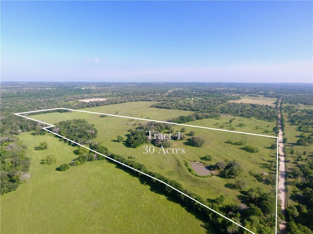 Restrictions: Unknown TRACT 4:  30 Acres Bring your ATV, hunting and fishing gear and enjoy the country. High ride building site. Century live oaks dot the landscape, a pond and a mixture of wooded and open areas. Isn't it time to move to the country to be self sufficient/reliant and build your off the grid dream place? Looking for more acreage, additional acreage adjourning this tract is available.  Some portion of this property lies in the 100 yr flood zone.