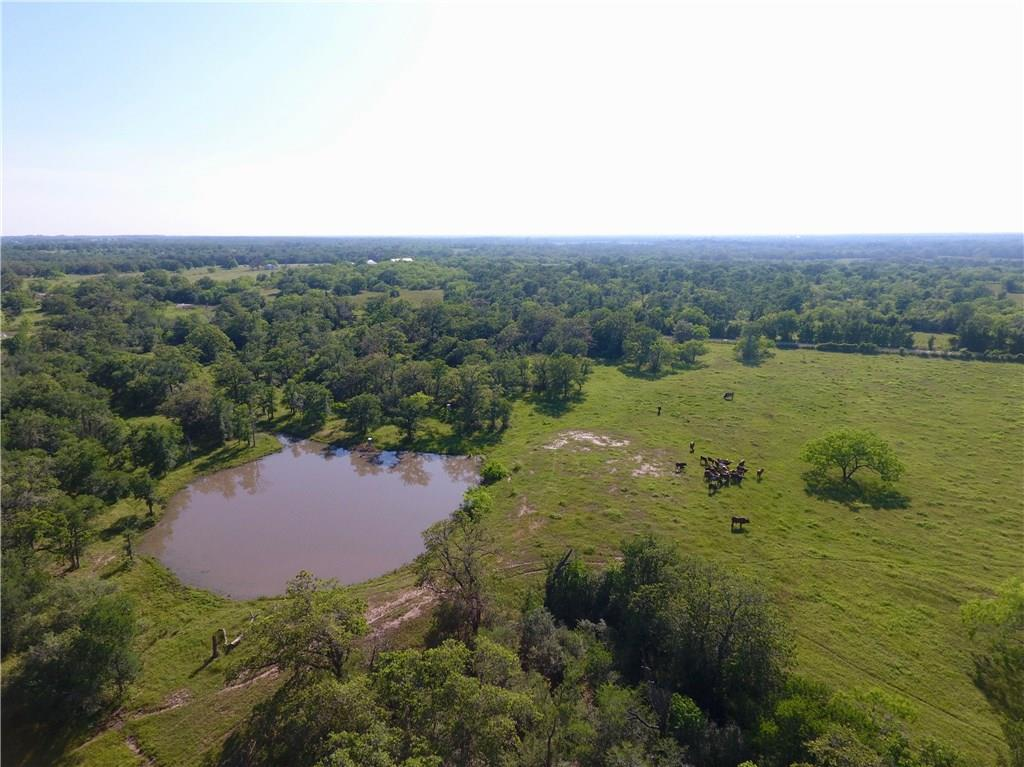 TRACT 3:  40 Acres centrally located between San Antonio, Houston, and Austin. Bring your ATV, hunting and fishing gear and enjoy the country. This tract has several great building sites to choose from. The property has a great shape, mature oaks, a stocked pond and has a heavily wooded and open areas, perfect for wildlife. Property is currently used for cattle grazing, hay production, and recreation. Looking for more acreage, additional acreage adjourning this tract is available.Restrictions: Yes