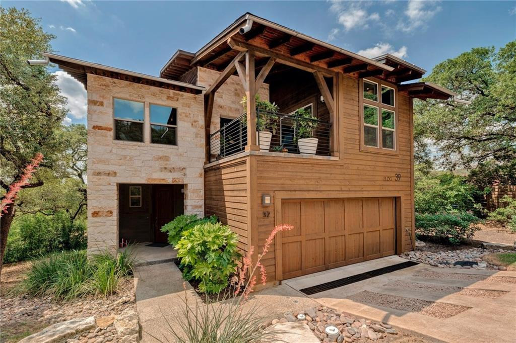 This lock & leave home, located on a .25 acre lot in the award winning Hillside community, is convenient to many locations in Austin including Domain, Downtown Austin and both Lake Austin and Lake Travis. The open concept main floor is designed with entertainment in mind w/large island for prepping dinner & hosting guests. The main floor boasts rich hardwood floors, Texas stone fireplace, abundant natural light, recessed lighting, high ceilings, gorgeous pendant lighting over the island, elegant dining fixture, and a serene patio overlooking the backyard. The 2nd floor features a large separate home office with enough room for two desks and glass doors to the covered balcony, loft with soaring ceilings, 2 guest bedrooms, guest bath with walk in shower, and second floor laundry. The generous owner's suite offers privacy up in the treetops with light streaming through the windows, room for a seating area and also features a luxurious en suite bath. Top off all of these wonderful features with water wise landscaping, 2 car garage & perfect location for an easy commute to Downtown, Domain or South Austin. Enjoy the stunning Hill Country and Downtown Austin views from the relaxing resort style community pool complete with hot tub, outdoor kitchen and fireplace.