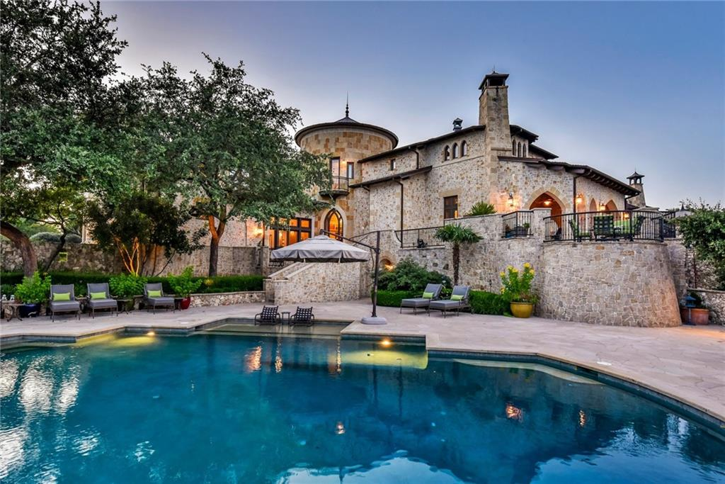 Located on the most private & prestigious street in Barton Creek and situated on 5 lots totaling 4.04 acres overlooking the #6 green this unique home is truly one of Austin's finest residences. Designed by renowned David Shiflet and brought to life by the unequivocal builder Gary Reissig, 2401 Portofino Ridge, exudes splendor and delights visitors. Estate features an elevator, wine cellar, game room, grand living, wet bar, guest accommodations, exquisite finishes, 4-car attached & 8+ car detached garage.Guest Accommodations: Yes Restrictions: Yes Comm. Features: Health Club Discount  Sprinkler Sys:Yes