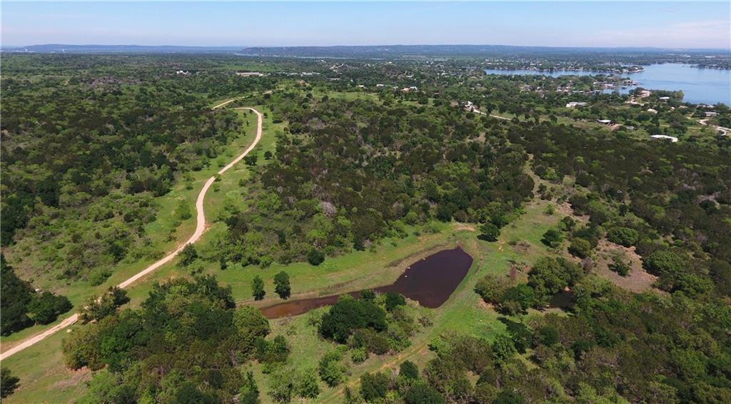411+ Acre Llano Hill Country Ranch! Across the road from constant level Lake LBJ.  Beautiful panoramic lake and Hill Country views.  One of the best all-around hunting Ranches in Llano county, with year-round Sandy Creek.  MLD permit hunting, longer than normal season, 10/1-2/28 with 40-50 tags every year.  Walk to Marina and boat ramp.  Investment opportunity, income from paid hunts.  Minutes from Horseshoe Bay golf resort. This ranch has it all! Always something to do for the entire family.  1Hr to ATX.FEMA - Unknown Restrictions: Yes