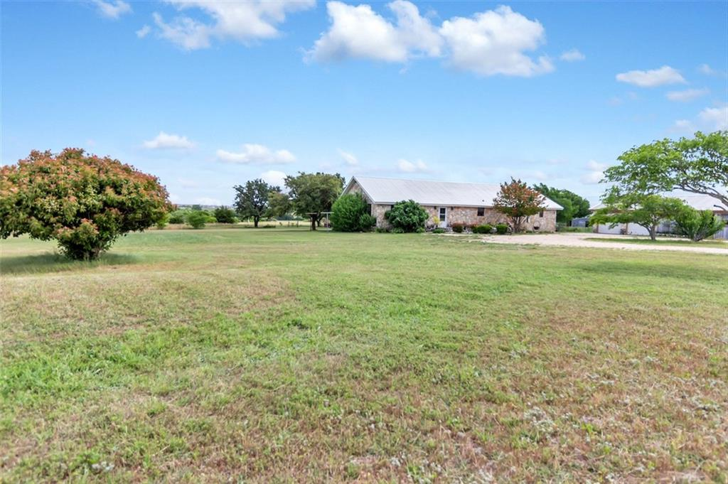 NO RESTRICTIONS, Great location. 4parcels (R324302,R515811,R515812 and R011285) and 2 homes for a total of 28.44 acres with a 2,266 sf house, barn and shed and 1570 Sqft house. 100 percent perimeter fenced.  The property has a shared access driveway, has 600 feet of county road frontage and could be easily divided. Home sit well away from the road. NO RESTRICTIONS!