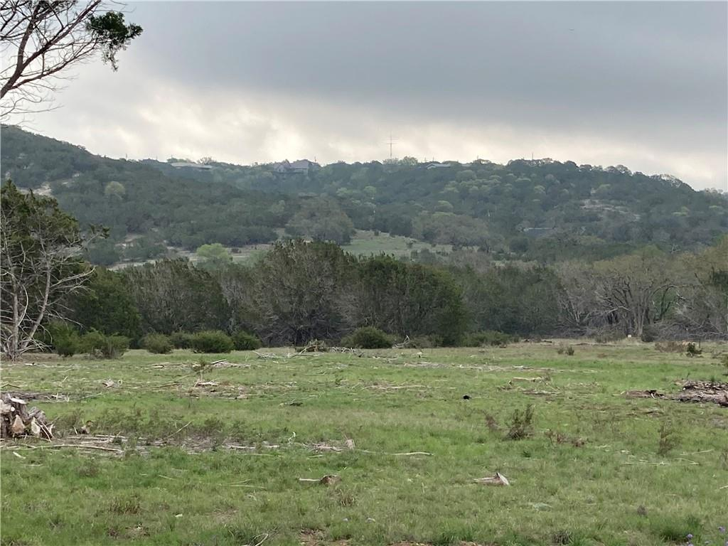 Dreaming of owning your own private 20 acre ranch minutes from downtown Kerrville? This is it!  Gorgeous oaks, pecan, etc. grace this property throughout! Deep ravines, trails, with beautiful views. Private, secluded, many homesite areas for you to choose from. Electric availabe and city waterline coming very soon! Completely fenced with good livestock fencing. Seller has contract with company to clear all cedar trees off the property. Wet Weather creek on property as well. Owner open to offers. MUST SEE!