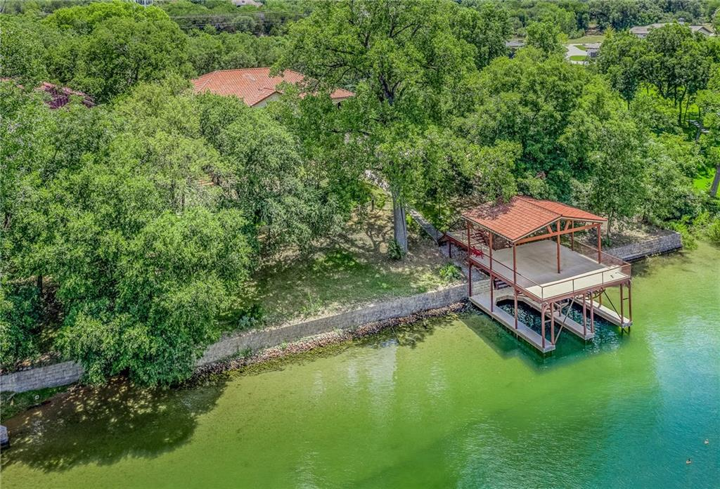 Beautiful newly constructed Mediterranean Custom built on Lake Austin front property, with gated entry. Quietest part of Lake Austin. Covered boat dock with an electronic lift for your boat/jet ski. Kick back, relax, & enjoy the peaceful view from the dock's covered party deck. Have coffee every morning from your balcony while enjoying the serene, nature setting all around you. Located on 1.59 acre property, has three sources of water, & is on WD#17 sewer. Contact List Agent or Broker for gate entry info.Restrictions: Yes  Sprinkler Sys:Yes