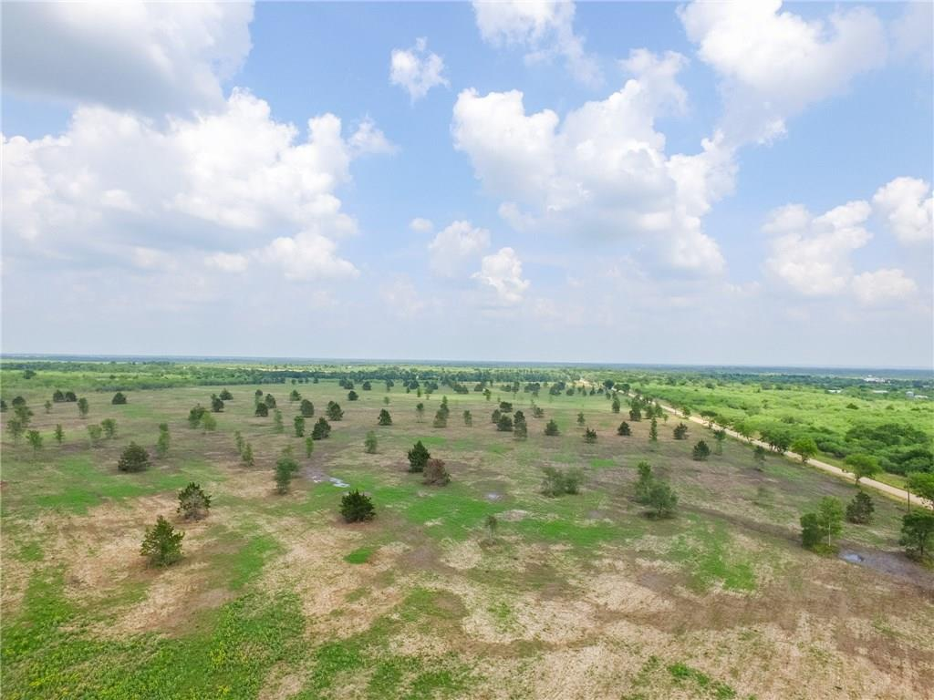 LOT 5 is 7.84 acres and sits just off of FM 1115 on CR 451 (Sparta Field Road). Seller has contracted with Fayette County Water Supply Corp and GVEC to have water and electric installed in the easement for these lots to connect to. Nice elevation changes with trees dotted through the cleared lot. Newly created subdivision Independence Landing in Gonzales county is 10 tracts of 3.7 up to 19 acres with light restrictions (no manufactured homes among others). Seller is offering Owner financing.